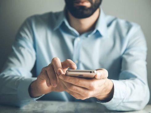man touching smart phone screen