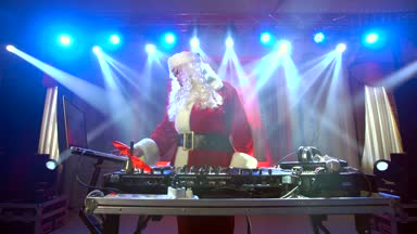 depositphotos_130856458-stock-video-dj-santa-claus-mixing-up