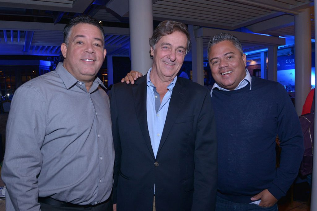 Farley Hollander, Victor Dapena y Herman Harms.