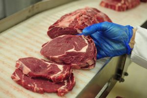 An employee selects cuts of Irish rib-eye beef steak as they work on the packaging line at ABP Foods Group's meat processing plant in Cahir, Ireland, on Wednesday, Jan. 14, 2015. The U.S., the world's biggest beef consumer, is lifting a ban on imports from Ireland more than 15 years after mad cow disease spurred restrictions of supplies from Europe. Photographer: Aidan Crawley/Bloomberg